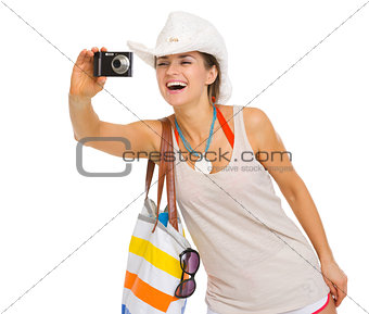 Happy beach young woman taking photo with camera