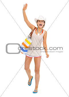 Happy beach young woman saluting