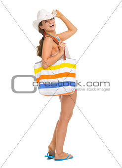 Full length portrait of smiling beach young woman