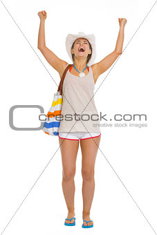 Full length portrait of beach young woman rejoicing success