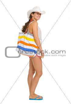 Full length portrait of happy beach young woman