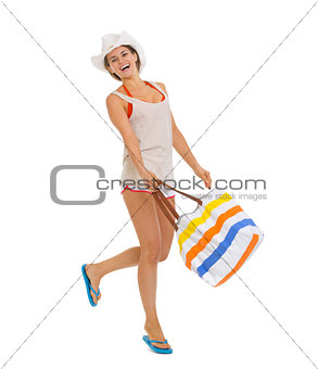 Full length portrait of happy beach young woman jumping