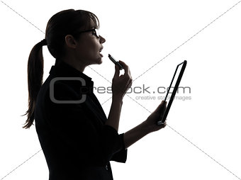 business woman applying lipstick computer computing  digital tab