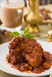 curry chicken, indian cuisine with traditional food items on bac