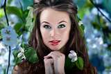 Gorgeous girl with flowers in hair, proffesional make up StockPhoto