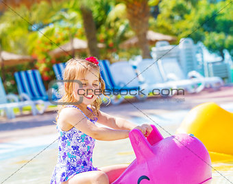 Baby girl in aquapark