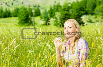 Cute girl on wheat field