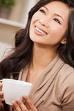 Beautiful Chinese Oriental Asian Woman Drinking Tea or Coffee