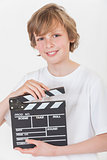 Happy Boy Smiling With Clapperboard