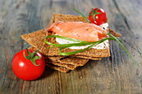 Toast the bread from grain and salmon.