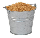 Light brown soft / muscovado sugar in a miniature metal bucket
