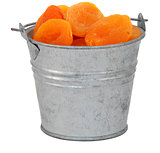 Dried apricots in a miniature metal bucket