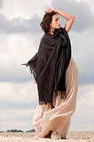attractive and sensuality woman dancing in the desert