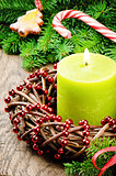 Christmas advent wreath with burning candle and festive decorati