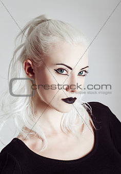 Studio portrait of beautiful blonde girl. Closeup