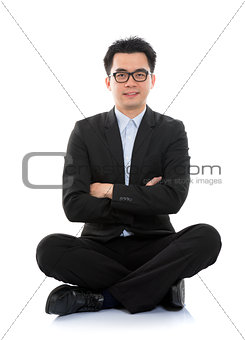 Asian business man sitting on floor