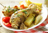 baked chicken legs with vegetables for garnish