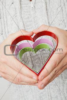 Heart symbols held in hands