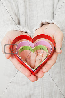 Heart symbols held in hands