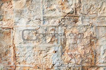A weathered natural sandstone brick wall