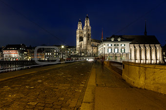 View on Grossmunster Church and Munsterbrucke Bridge in the Even