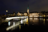 Illuminated Fraumunster Church and River Limmat in Zurich, Switz