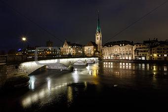 Illuminated Fraumunster Church and River Limmat in Zurich, Switz