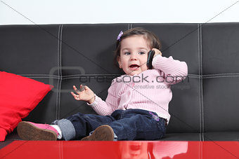 Casual baby taking a conversation with a mobile phone