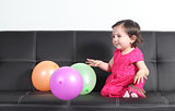 Baby happy playing with balloons