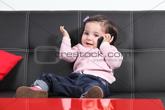 Casual baby playing happy with a mobile phone