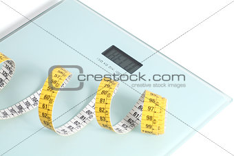 Close up of a scale with a tape measure