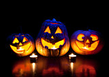Halloween pumpkins glowing inside