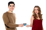 Boyfriend handing over the credit card to his girl