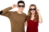 Young couple posing to camera with shades on