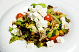 Summer salad with toppings of feta cheese