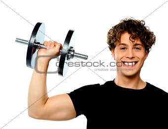 Powerful muscular young man lifting weight
