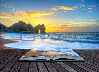 Vibrant sunrise over ocean with rock stack in foreground in page