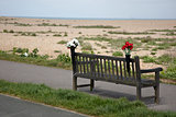 Empty bench with flowers on Kent coast