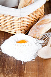 bread, flour, eggs and kitchen utensil