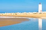 Blue Beach With Lighthouse