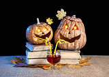 Funny Halloween pumpkins drinking wine