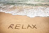 Relax word on the sand