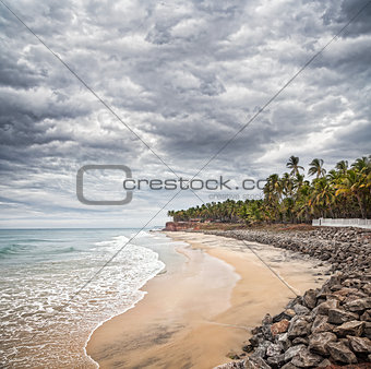 Tropical beach with dramatic sky
