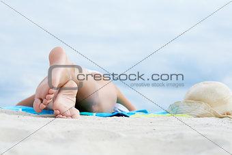 Feet of sunbather