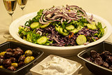 Salad dish, olives, caviar