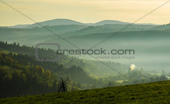 The Carpathian Mountains in the morning through the fog