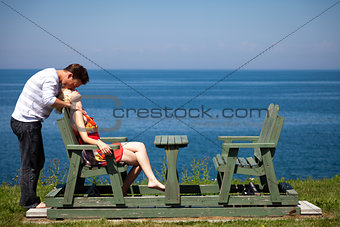 Romantic couple sitting on the bench