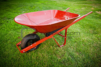 Red trolley on the lawn