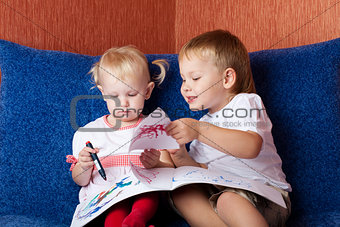 two children looking painting