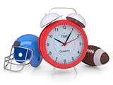 Alarm clock, football helmet and ball